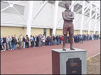Supporters queue for tickets at the Liberty Stadium