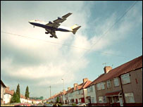 Aeroplane flies low over houses.  Image: BBC