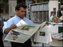 Man reading a newspaper in Iran
