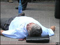 Kyrgyz parliament member Jyrgalbek Surabaldiyev's body lies on a pavement, left, June 10, 2005