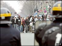 Riot police face demonstrators in Paris