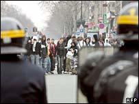 Riot police face demonstrators in Paris