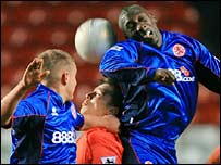Chartlon's Matt Holland is caught between Boro's Lee Cattermole and Jimmy Floyd Hasselbaink