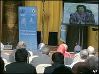 Col Muammar Gaddafi speaks during the video conference