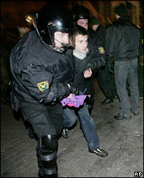 Police detain a protester