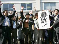 Plaintiffs and lawyers celebrate outside court in Ishikawa, Japan - 24/3/06
