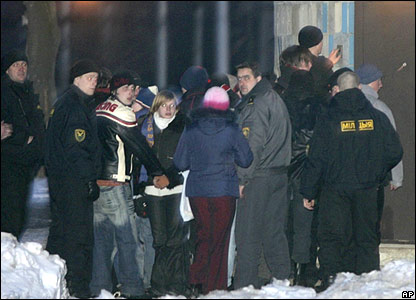 Detainees surrounded by police outside a prison in Minsk