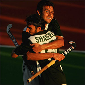 Hockey player Shakeel Abbasi of Pakistan celebrates scoring a goal