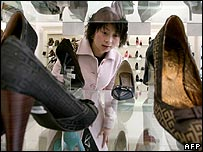 Chinese woman shopping for shoes