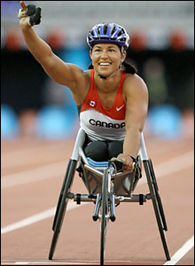 Chantal Petitclerc of Canada celebrates winning the women's 800 metre disabled final