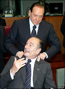 Italian Prime Minister Silvio Berlusconi jokes with French President Jacques Chirac
