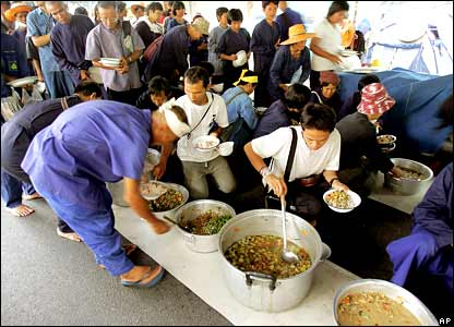 Demonstrators in Bangkok line up for food