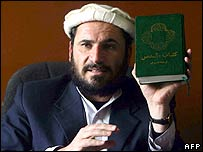 Afghan supreme court judge Ansarullah Mawlafizada holding the bible he says belonged to the accused