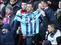 PSG fans burn a Marseille shirt