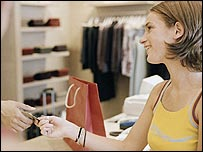 A young woman paying for some goods with a card