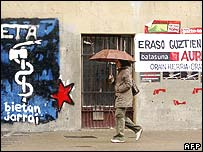 A woman walks past posters supporting Eta and Batasuna in Navarra province