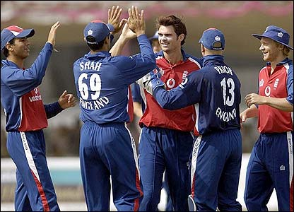 England's James Anderson is congratulated after removing Gautam Gambhir
