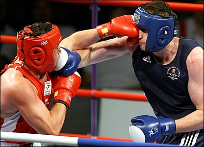 England's David Price (right) trades blows with Welshman Kevin Evans