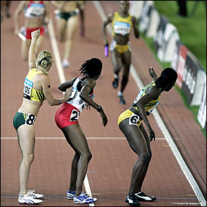 Natasha Danvers (centre) wrongly swapped places with Australia's Tamsyn Lewis (left) before receiving the baton