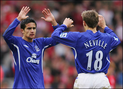 (l-r) Tim Cahill is congratulated by Phil Neville after scoring for Everton