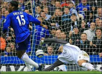 Didier Drogba scores past David James for Chelsea