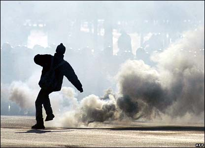 A protester stands amid smoke in Minsk, Belarus
