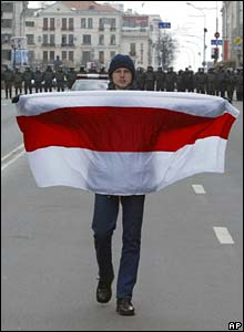 An opposition supporter carries an opposition flag in Minsk, Belarus