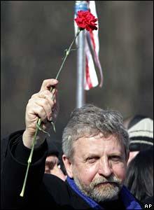 Alexander Milinkevich holds a red carnation