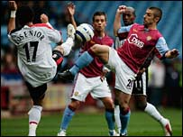 Villa's Kevin Phillips (right) tussles for the ball with Fulham's Liam Rosenior