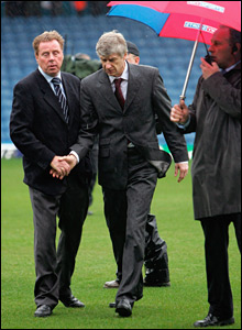 Portsmouth manager Harry Redknapp (l) shakes hands with Arsenal boss Arsene Wenger at Fratton Park