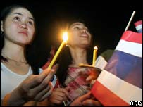 Thai protesters hold candles during a demonstration