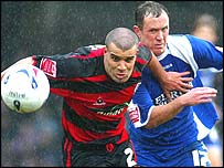Cardiff's Kevin Cooper and QPR's Marcus Bignot battle for the ball