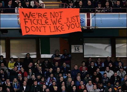 Aston Villa fans reveal an orange banner at Villa Park