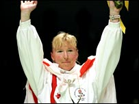 England's Tracey Hallam celebrates her gold