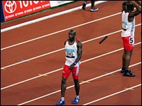 Marlon Devonish walks away from Mark Lewis-Francis after the England sprint team's relay howler