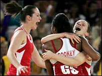 Pamela Cookey is congratulated by her England team-mates after her goal clinched the bronze