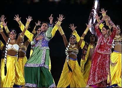 Bollywood stars Saif Ali Khan (green) and Rani Mukherjee (red) lead the dancing