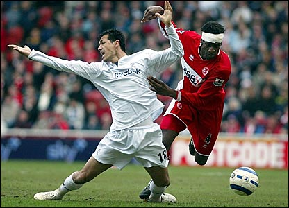 Bolton's Jared Borgetti (left) is fouled by Ugo Ehiogu