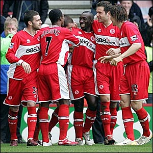 Jimmy Floyd Hasselbaink (centre) is congratulated after scoring his second goal