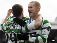 Maloney celebrates his goal with man-of-the-match Neil Lennon