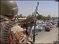 Iraqi soldier manning Baghdad checkpoint