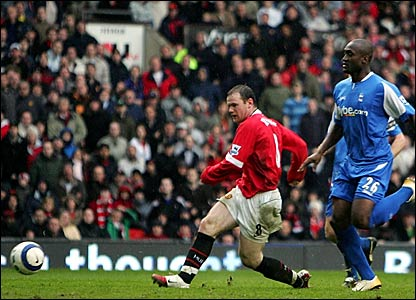 Wayne Rooney scores Manchester United's third goal against Birmingham