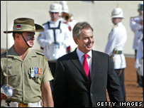 Tony Blair inspects the Australian Federal Guard outside the Parliament