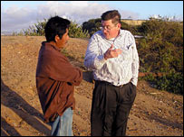 Attorney Mike Wischkaemper talks to a Mexican immigrant