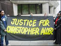 Christopher Alder's son and sister at demonstration