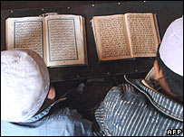 Muslim students read Koran at a religious school in Kabul