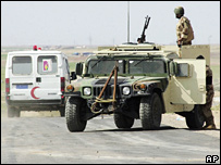 Ambulance on way to blast site passes Iraqi soldiers in Humvee