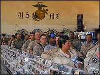 Soldiers queue to buy CDs in a PX store on al-Asad base, western Iraq