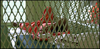 A detainee rests inside his cell at the Guantanamo Bay Naval Base