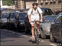 Cyclist and traffic jam.  Image: PA
